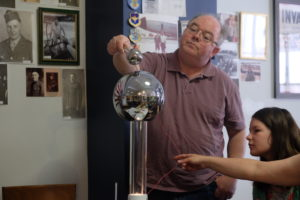 Joe Stutler enjoyed testing the Van de Graff generator.