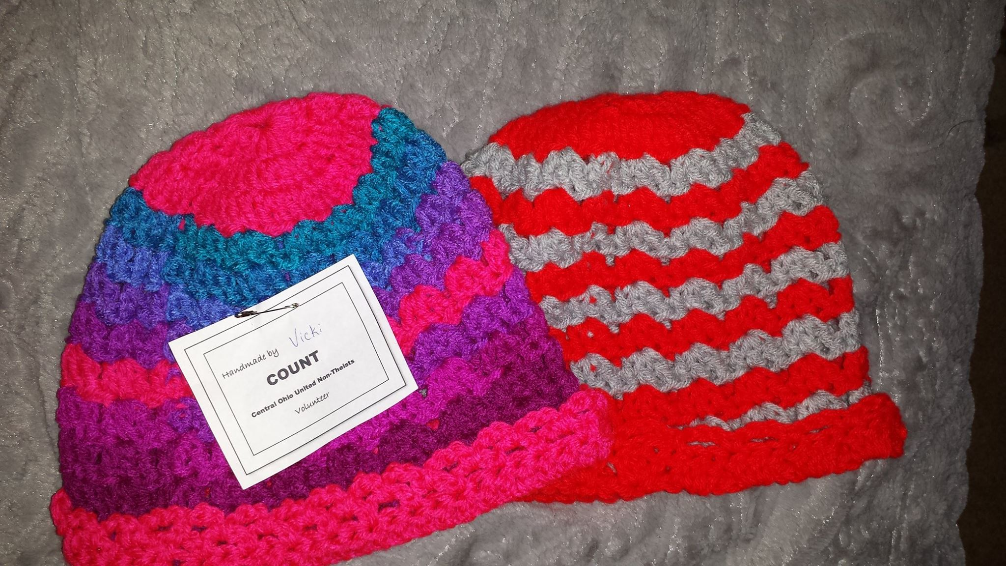Two knitted hats with COUNT label